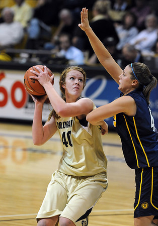 """Rachel Hargis looks to score over Brandi Collins of Regis.<br /> For more photos of the game, go to  <a href=""""http://www.dailycamera.com"""">http://www.dailycamera.com</a><br /> Cliff Grassmick / November 12, 2010"""