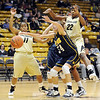 "Lauren Luebbe (34) of Regis is defended by Brittany Wilson, left, and Brittany Spears of CU.<br /> For more photos of the game, go to  <a href=""http://www.dailycamera.com"">http://www.dailycamera.com</a><br /> Cliff Grassmick / November 12, 2010"
