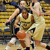 "Brittany Wilson (11) of CU gets past Jacque Machesney of Regis, and Meagan Malcolm-Peck of CU.<br /> For more photos of the game, go to  <a href=""http://www.dailycamera.com"">http://www.dailycamera.com</a><br /> Cliff Grassmick / November 12, 2010"