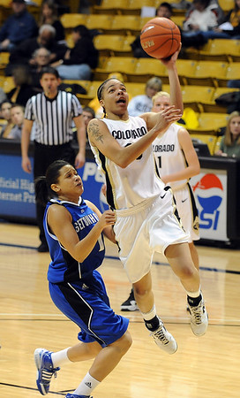Chucky Jeffery of Colorado drives in for a lay up against Seton Hall.<br /> Cliff Grassmick / December 6, 2009