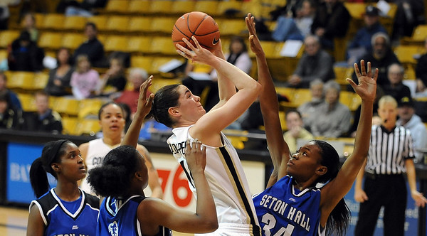 Meagan Malcolm-Peck of CU goes up among three Seton Hall players on Sunday.<br /> Cliff Grassmick / December 6, 2009