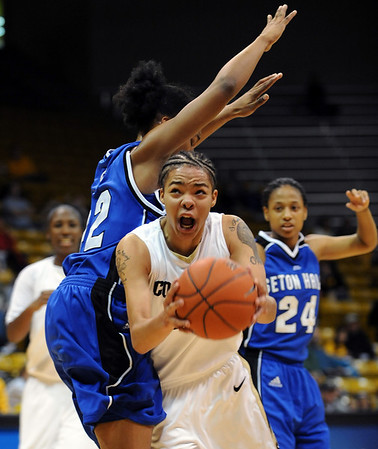 Chucky Jeffery of CU muscles in on Terry Green of Seton Hall on Sunday.<br /> Cliff Grassmick / December 6, 2009