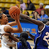 Chucky Jeffery of CU drives in the lane against Terry Green of Seton Hall.<br /> Cliff Grassmick / December 6, 2009