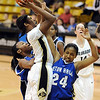 Brittany Spears of CU scores on Ebonie Williams of Seton Hall.<br /> Cliff Grassmick / December 6, 2009