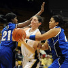 Meagan Malcolm-Peck of Colorado splits the Seton Hall defense on Sunday.<br /> Cliff Grassmick / December 6, 2009