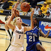 Alyssa Fressle of CU gets a rebound in front of Shanai Heber of Seton Hall.<br /> Cliff Grassmick / December 6, 2009