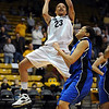 Chucky Jeffery of CU puts up a shot on Letitia Curry of Seton Hall on Sunday.<br /> Cliff Grassmick / December 6, 2009