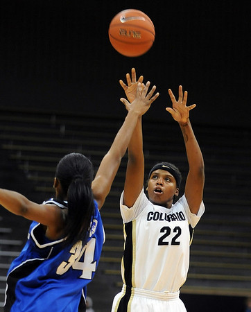 Brittany Spears  of CU puts up one of her threes against Letitia Curry of Seton Hall on Sunday.<br /> Cliff Grassmick / December 6, 2009