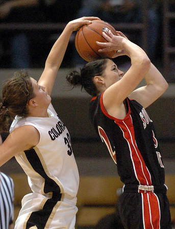 Kelly Jo Mullaney of CU, blocks the shot of Caitlyn Sears of Southern Utah.<br /> <br /> Cliff Grassmick / December 19, 2009
