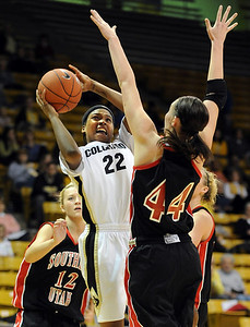 Brittany Spears of Colorado shoots over Chanel Thorley of Southern Utah.  Cliff Grassmick / December 19, 2009