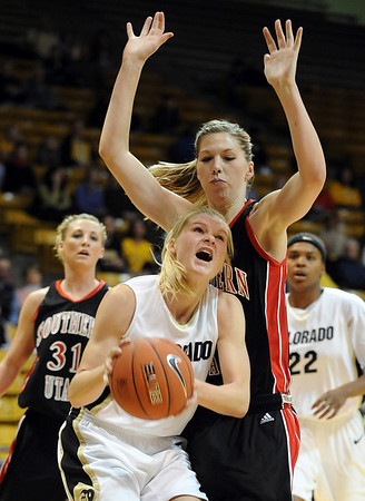 Alyssa Fressle of CU goes inside Challis Pascucci of S. Utah.<br /> <br /> Cliff Grassmick / December 19, 2009