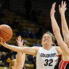 Kelly Jo Mullaney  of CU stretches out to score on Challis Pascucci of S. Utah.<br /> Cliff Grassmick / December 19, 2009