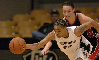 Chucky Jeffery of Colorado gets a steal in front of Chanel Thorley of S. Utah.  Cliff Grassmick / December 19, 2009