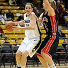 Meagan Malcolm-Peck of CU goes around Challis Pascucci of S. Utah.<br /> <br /> Cliff Grassmick / December 19, 2009