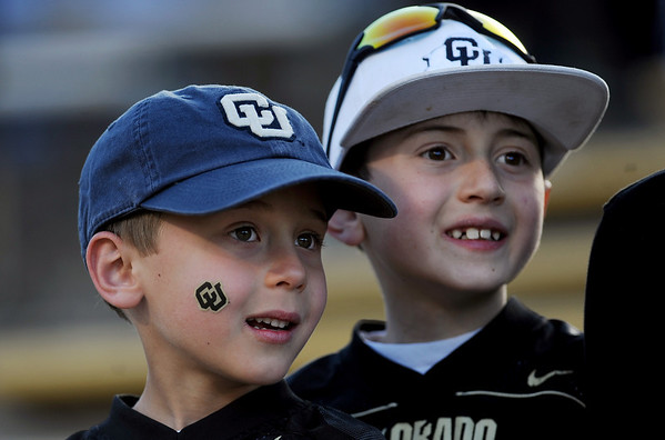 "Riley Wilson, left, 6, and his brother Brady, 8, appear to be stargazing when watching the University of Colorado Buffaloes Spring football game Saturday night.<br /> For more photos of the game and a video of the alumni game, go to  <a href=""http://www.dailycamera.com"">http://www.dailycamera.com</a>.<br /> Cliff Grassmick/ April 9, 2011"