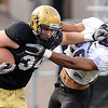 Colorado tight end, Ryan Deehan, pushes awayRay Polk of the CU defense during the Colorado Buffaloes' spring game on April 9, 2011 at Folsom Field in Boulder.<br /> <br /> Cliff Grassmick/ April 9, 2011