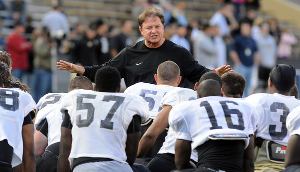 """Greg Brown talks to his defense before the Spring game.<br /> For more photos of the game and a video of the alumni game, go to  <a href=""""http://www.dailycamera.com"""">http://www.dailycamera.com</a>.<br /> Cliff Grassmick/ April 9, 2011"""