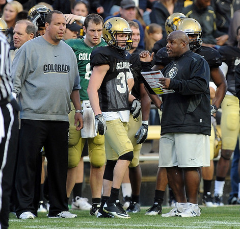 "Bobby Kennedy, left, and Eric Bieniemy coaching during the Spring game.<br /> For more photos of the game and a video of the alumni game, go to  <a href=""http://www.dailycamera.com"">http://www.dailycamera.com</a>.<br /> Cliff Grassmick/ April 9, 2011"