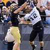 Patrick Mahnke (12) knocks away a pass for Kyle Slavin  during the Colorado Buffaloes' spring game on April 9, 2011 at Folsom Field in Boulder.<br /> Cliff Grassmick/ April 9, 2011