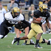 Colorado running back, Tony Jones, takes off on a long with Josh Hartigan in pursuit  during the Colorado Buffaloes' spring game on April 9, 2011 at Folsom Field in Boulder.<br /> Cliff Grassmick/ April 9, 2011