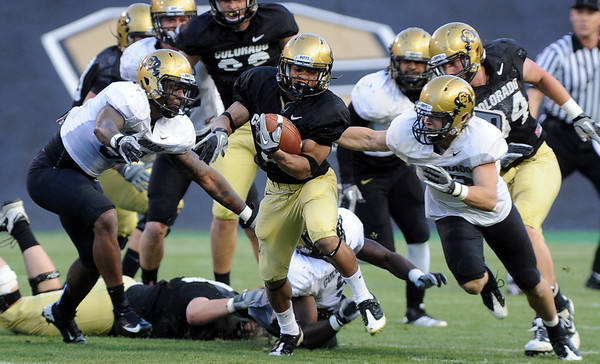 Colorado Running back, Rodney Stewart, breaks away from defenders  during the Colorado Buffaloes' spring game on April 9, 2011 at Folsom Field in Boulder.<br /> Cliff Grassmick/ April 9, 2011