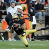 Colorado receiver, Keenan Canty, makes a diving catch in front of Terrel Smith during the Colorado Buffaloes' spring game on April 9, 2011 at Folsom Field in Boulder.<br /> Cliff Grassmick/ April 9, 2011