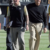 "Former CU coaches, Bill McCartney, left, and Gary Barnett, walks in Folsom Field again.<br /> For more photos of the game and a video of the alumni game, go to  <a href=""http://www.dailycamera.com"">http://www.dailycamera.com</a>.<br /> Cliff Grassmick/ April 9, 2011"
