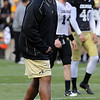 Colorado head coach, Jon Embree, gets after the Buffalo defense after the offense scores  during the Colorado Buffaloes' spring game on April 9, 2011 at Folsom Field in Boulder.<br /> Cliff Grassmick/ April 9, 2011