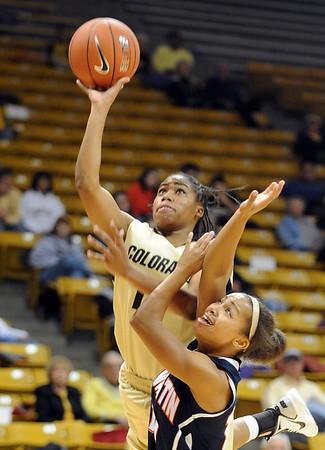 "Brittany Wilson of CU scores on Becca Thomas of Tenn-Martin.<br /> For more photos of the game, go to  <a href=""http://www.dailycamera.com"">http://www.dailycamera.com</a>.<br /> Cliff Grassmick / November 21, 2010"