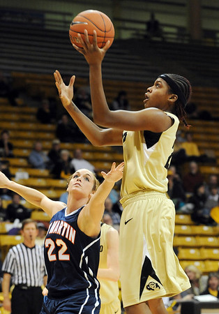 "Brittany Spears of Colorado shoots over Alecia Weatherly of Tenn.-Martin.<br /> For more photos of the game, go to  <a href=""http://www.dailycamera.com"">http://www.dailycamera.com</a>.<br /> Cliff Grassmick / November 21, 2010"