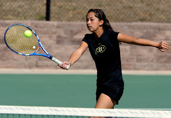 Allison Wahba of CU hits a shot back in one of her Saturday matches.<br /> Cliff Grassmick / September 26, 2009