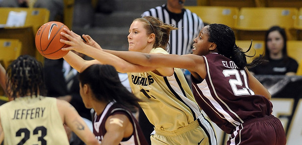 "Julie Seabrook of CU keeps the ball away from Adaora Elonu of Texas A&M.<br /> For more  photos of the game, go to  <a href=""http://www.dailycamera.com"">http://www.dailycamera.com</a>.<br /> Cliff Grassmick / February 27, 2010"