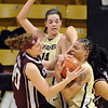 "Kelsey Assarian, left, of Texas A&M, and Chucky Jeffery of CU fight for the ball.<br /> For more  photos of the game, go to  <a href=""http://www.dailycamera.com"">http://www.dailycamera.com</a>.<br /> Cliff Grassmick / February 27, 2010"