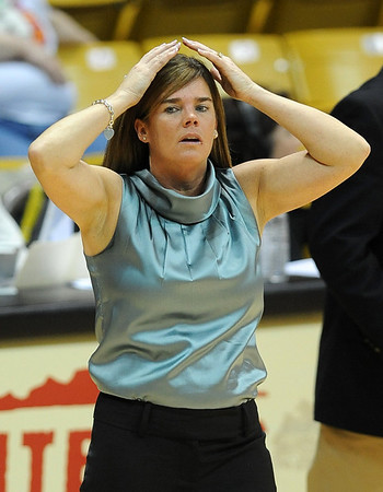 "CU coach Kathy McConnell-Miller prepares to talk to her team against Texas A & M on Saturday.<br /> For more  photos of the game, go to  <a href=""http://www.dailycamera.com"">http://www.dailycamera.com</a>.<br /> Cliff Grassmick / February 27, 2010"