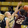 """Alyssa Fressle of Colorado pressures Tanisha Smith of Texas A&M.<br /> For more  photos of the game, go to  <a href=""""http://www.dailycamera.com"""">http://www.dailycamera.com</a>.<br /> Cliff Grassmick / February 27, 2010"""