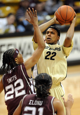 "Brittany Spears of CU shoots over Tanisha Smith of Texas A&M.<br /> For more  photos of the game, go to  <a href=""http://www.dailycamera.com"">http://www.dailycamera.com</a>.<br /> Cliff Grassmick / February 27, 2010"
