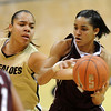 "Bianca Smith of CU tries to get the ball from Sydney Carter of Texas A&M on Saturday.<br /> For more  photos of the game, go to  <a href=""http://www.dailycamera.com"">http://www.dailycamera.com</a>.<br /> Cliff Grassmick / February 27, 2010"