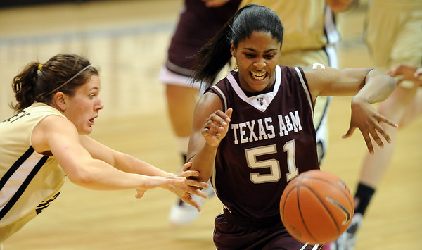 """Kelly Jo Mullaney of CU knocks the ball from Sydney Colson of Texas A&M.<br /> For more  photos of the game, go to  <a href=""""http://www.dailycamera.com"""">http://www.dailycamera.com</a>.<br /> Cliff Grassmick / February 27, 2010"""