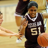"Kelly Jo Mullaney of CU knocks the ball from Sydney Colson of Texas A&M.<br /> For more  photos of the game, go to  <a href=""http://www.dailycamera.com"">http://www.dailycamera.com</a>.<br /> Cliff Grassmick / February 27, 2010"