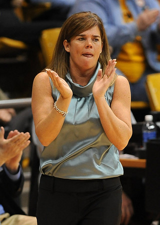 "CU coach Kathy McConnell-Miller encourages her team against Texas A & M on Saturday.<br /> For more  photos of the game, go to  <a href=""http://www.dailycamera.com"">http://www.dailycamera.com</a>.<br /> Cliff Grassmick / February 27, 2010"