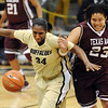 "Courtney Dunn, left, of CU and Danielle Adams of Texas A&M chase down a loose ball on Saturday.<br /> For more  photos of the game, go to  <a href=""http://www.dailycamera.com"">http://www.dailycamera.com</a>.<br /> Cliff Grassmick / February 27, 2010"