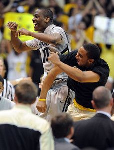 Alec Burks, left, and Carlon Brown of CU, celebrate near the end of the Texas game. For more photos of the game, go to www.dailycamera.com Cliff Grassmick / February 26, 2011