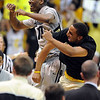 "Alec Burks, left, and Carlon Brown of CU, celebrate near the end of the Texas game.<br /> For more photos of the game, go to  <a href=""http://www.dailycamera.com"">http://www.dailycamera.com</a><br /> Cliff Grassmick / February 26, 2011"