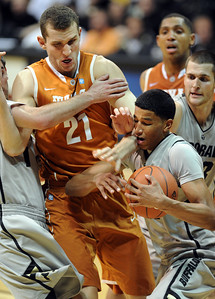 Andre Roberson of CU grabs a rebound from Matt Hill of Texas. For more photos of the game, go to www.dailycamera.com Cliff Grassmick / February 26, 2011