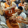 "Andre Roberson of CU grabs a rebound from Matt Hill of Texas.<br /> For more photos of the game, go to  <a href=""http://www.dailycamera.com"">http://www.dailycamera.com</a><br /> Cliff Grassmick / February 26, 2011"
