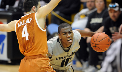 Alec Burks drives to the basket against Dogus Balbay of  Texas. For more photos of the game, go to www.dailycamera.com Cliff Grassmick / February 26, 2011