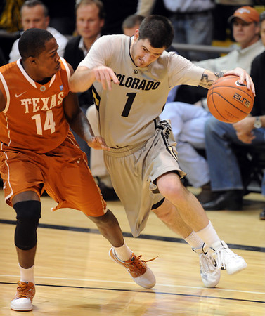 "Nate Tomlinson of CU collides with J'covan Brown of Texas.<br /> For more photos of the game, go to  <a href=""http://www.dailycamera.com"">http://www.dailycamera.com</a><br /> Cliff Grassmick / February 26, 2011"