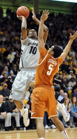 """Alec Burks of Colorado puts up a shot on Cory Joseph of Texas.<br /> For more photos of the game, go to  <a href=""""http://www.dailycamera.com"""">http://www.dailycamera.com</a><br /> Cliff Grassmick / February 26, 2011"""