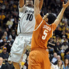 "Alec Burks of Colorado puts up a shot on Cory Joseph of Texas.<br /> For more photos of the game, go to  <a href=""http://www.dailycamera.com"">http://www.dailycamera.com</a><br /> Cliff Grassmick / February 26, 2011"