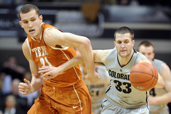 """Matt Hill, left, of Texas, and Austin Dufault of CU chase down a loose ball.<br /> For more photos of the game, go to  <a href=""""http://www.dailycamera.com"""">http://www.dailycamera.com</a><br /> Cliff Grassmick / February 26, 2011"""